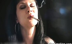 Sexy brunette hoe smokes a cigarette