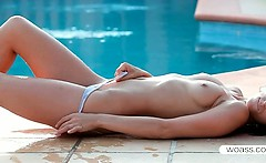 Superb Paloma satisfying her fuck hole by the pool