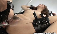 Nasty Asian slut in bondage gets her muff teased