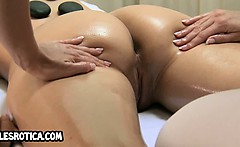 Sexy brunette lesbian getting an oily massage