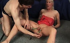Nasty blonde mature slut gets her wet twat tied and spanked