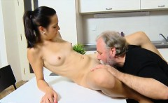 sexy brunette lora and her man are in the kitchen together,