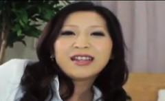 Asian MILF Giving A Footjob