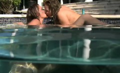 Young lesbian threeway underwater with big strapon