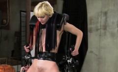 Blonde bound in standing frame flogged