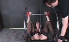 Stockinged sex slave gets labias clipped