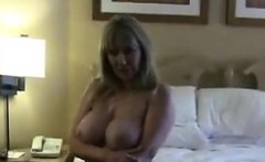 Blonde Woman Shows Off Her Big Breasts