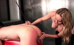 Busty blonde dominatrix slapping male ass