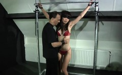 Asian slave reddened and bruised in bdsm scene