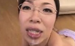 Mature Asian Woman Sucking On A Cock