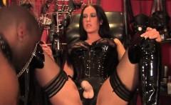 BDSM mistress dominates sub with strapon