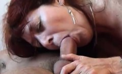 Redhead Mom in stockings blowing cock