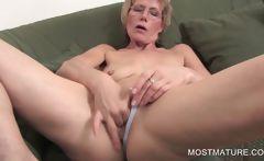 Mature blondie fingering pussy