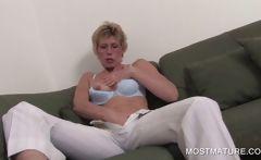 Blonde mature spreading pink cunt