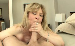 Horny blonde cougar in black stockings sucks cock and gets fucked in bed