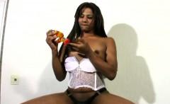 Naughty ebony t-girl strokes her extreme black mamba shecock