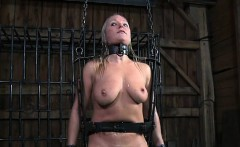 Beauty gets her pussy gratified while inside a cage