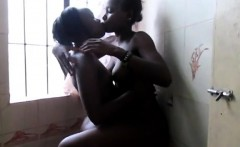 Beautiful African girlfriends having fun in the bathroom