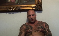 Tattoed muscular stud works out his cock in front of the cam
