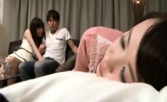 Two attractive Japanese babes take turns enjoying a throbbi