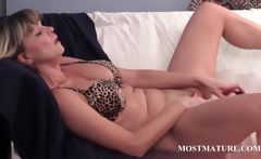Mature blondie riding a big dildo
