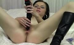 dark haired babe masturbates with dildo and fingering