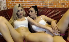 Blonde and Brunette lesbians making love with sex toy