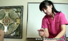 Mature masseuse massaging slong during session