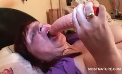 Mature redhead self fucking with vibrator in bed