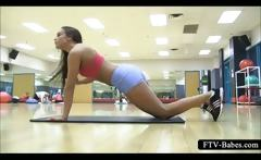 Brunette in tight outfit spreading hot legs at the gym