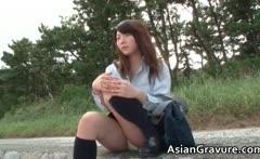 Cute japanese schoolgirl posing in sexy