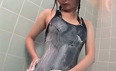 Sexy asian teen in swimsuit showers