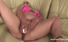 Lonely blonde mature using her favorite dildo to masturbate