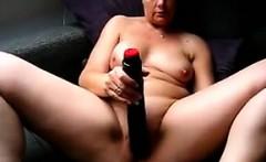 Fat Lady Masturbates With A Long Black Toy