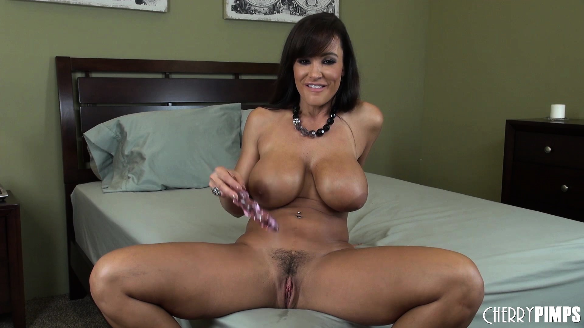Stacked Lisa Ann drills her slit with a dildo and moans with pleasure