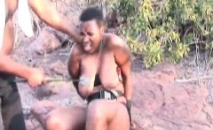 Busty Africa slave gets tied and spanked in nature