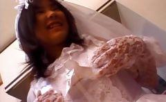 Asian in bride dress touching her body