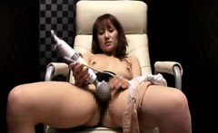 Horny Asian babe sits in the chair and vibrates her clit to