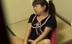 Asian teen rubs pussy