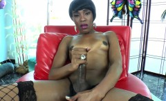 Stockinged ebony tgirl jerking her hard cock