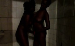 Lovely black best friends enjoy showering together. They