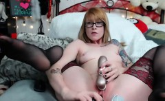 Redhead beauty uses hands to masturbate