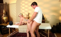 Busty massage beauty doggystyled by masseur