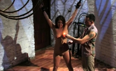 Slave girl is torturing in dungeon by clamps and hot wax.