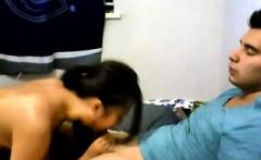 Amateur Asian teen sucks a big cock