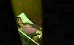 Cute brunette caught masturbating by a window peeper