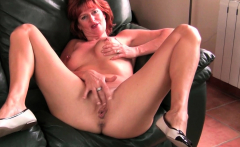 British and redhead milf Ginger Tiger dildos her fanny