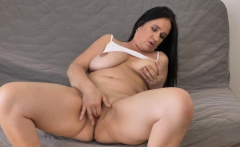 Euro milf Ria Black strips off and rubs her bald pussy