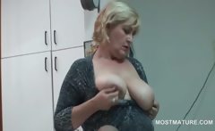 Office lady teasing her mature boobs with a banana