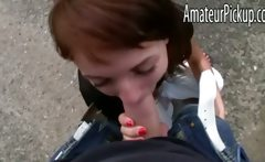 Brunette teen girl gives head outdoors